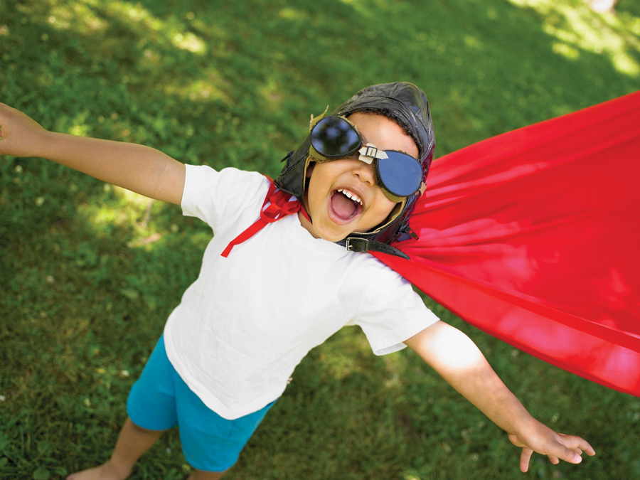 Partners Individuals Index - boy playing with cape and goggles