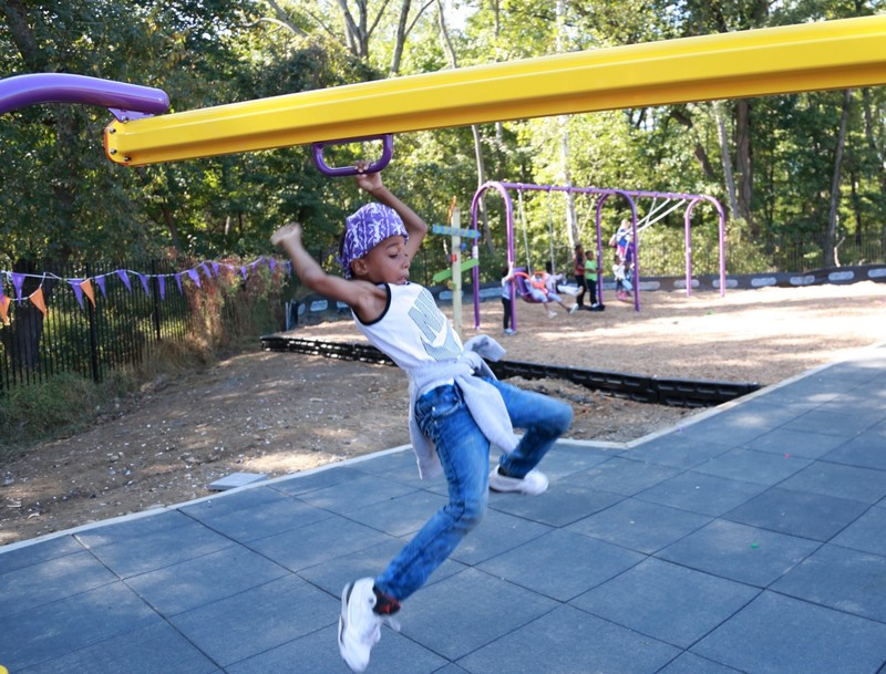 Kid uses a playground zip line