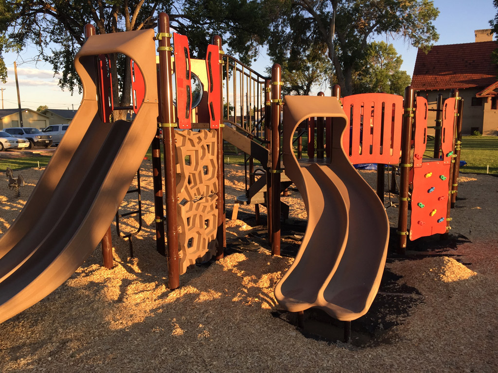 A completed KABOOM! and The Colorado Health Foundation playground at sunset