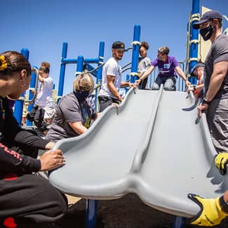 Stephen Curry and Ayesha Curry install a playground slide with help from KABOOM!